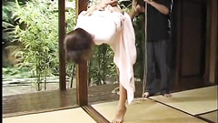 Man is playing with the hanging Asian body