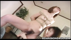 Bound girl gets her mouth and holes fed with toys