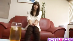 Long haired Asian babe is getting drunk and sucking huge dildo