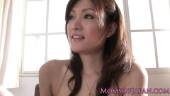 Adorable Japanese girl is sexily undressing and hotly masturbating