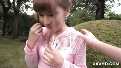 Clothed girl does blowjob in the park