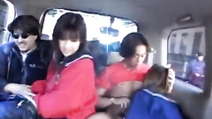 Japanese teens are getting hot in taxi and starting group fuck