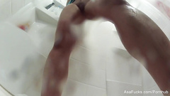 Naughty Japanese girl Asa Akira sets the camera on the floor and records herself in shower